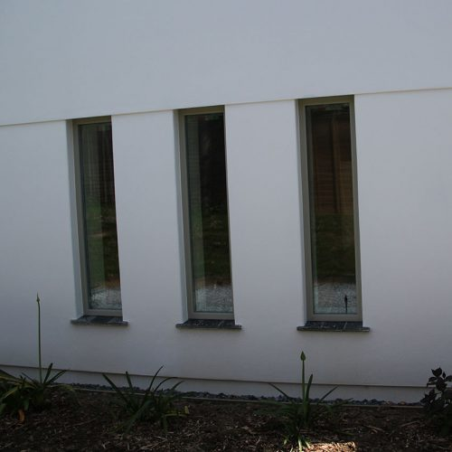 Green bespoke uPVC windows