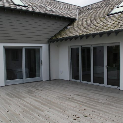 Grey bifold doors and sliding patio doors