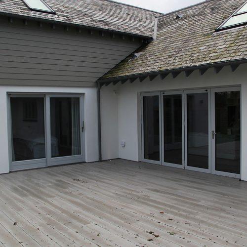 Grey bifold doors and sliding patio doors