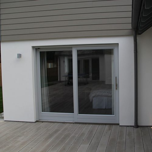 Grey sliding patio door installation