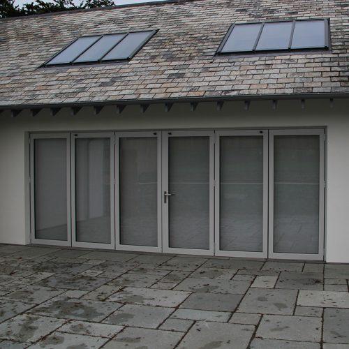 Wide grey bifold door installation